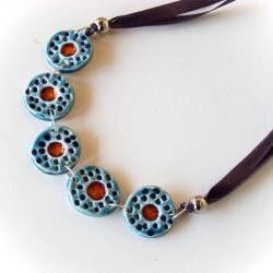 Statement necklace in shades of blue and red ceramic jewelry spring collection